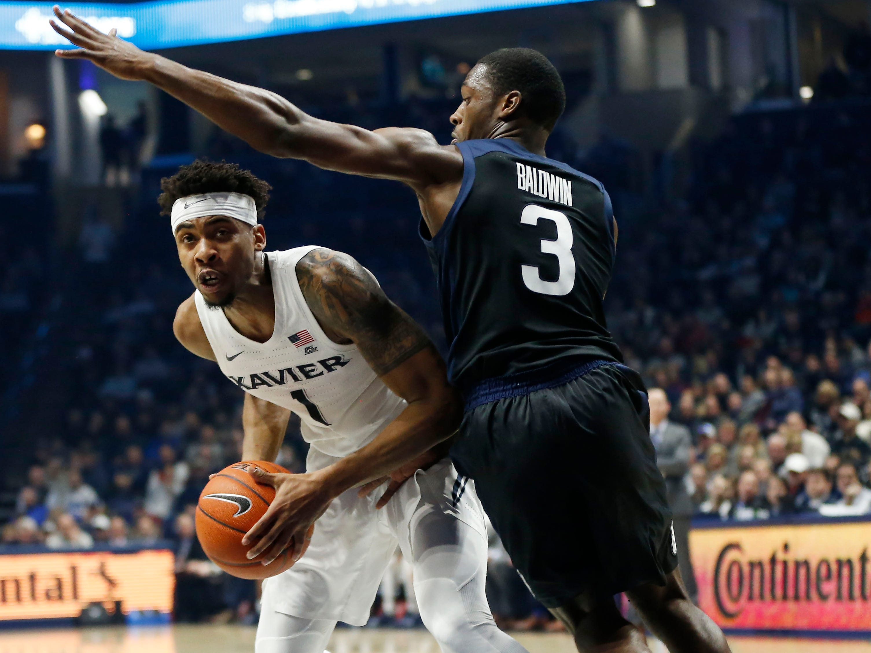 Jan 13, 2019; Cincinnati, OH, USA; Xavier Musketeers guard Paul Scruggs (1) looks to pass during the first half against the Butler Bulldogs guard Kamar Baldwin (3) at the Cintas Center.