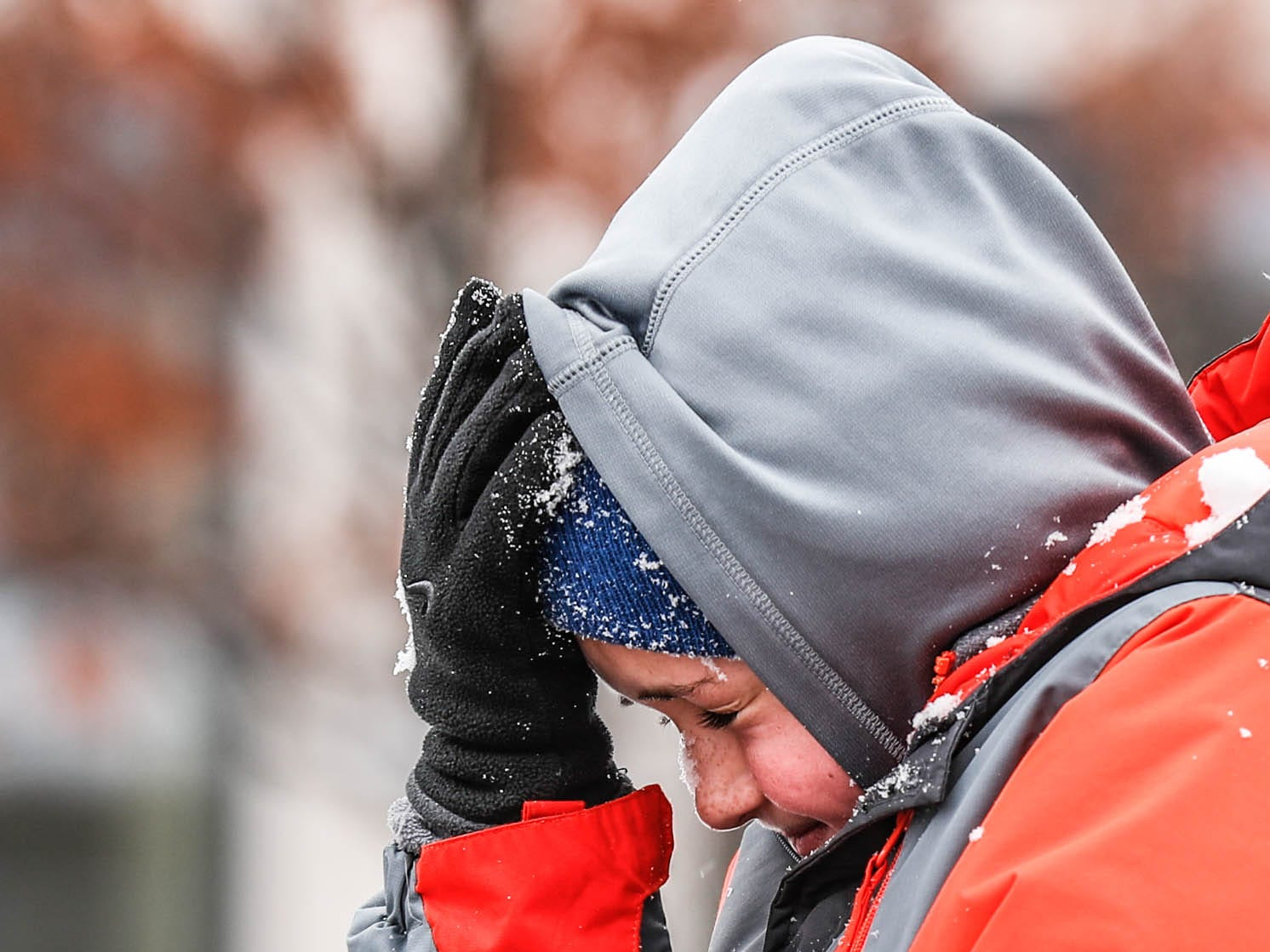 Quin Hendrich reacts to a snow clump in his face thrown by his brother during the second annual Carmel Festival of Ice, held at Center Green in Carmel Ind. on Sunday, Jan. 13, 2019.