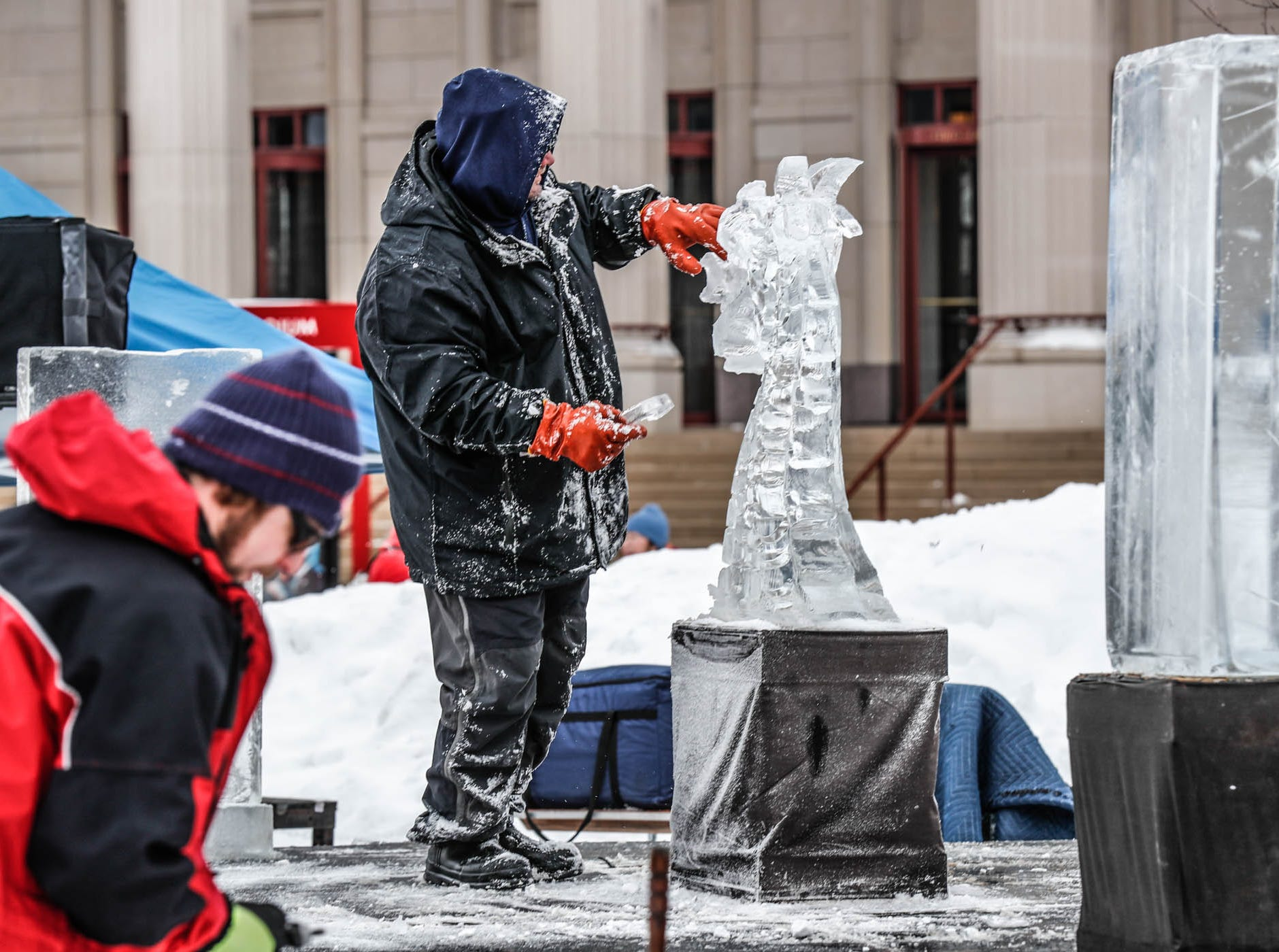 "Sculptor Greg Butauski creates a dragon sculpture for a speed ""carve off"" which took place during the second annual Carmel Festival of Ice, held at Center Green in Carmel Ind. on Sunday, Jan. 13, 2019."