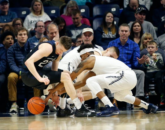 Jan 13, 2019; Cincinnati, OH, USA; Xavier Musketeers guard Paul Scruggs (1) goes for the ball during the first half against the Butler Bulldogs forward Sean McDermott (22) at the Cintas Center.