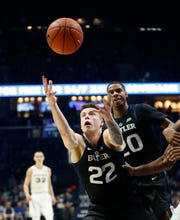 Jan 13, 2019; Cincinnati, OH, USA; Butler Bulldogs forward Sean McDermott (22) goes for the ball during the first half against the Xavier Musketeers at the Cintas Center.