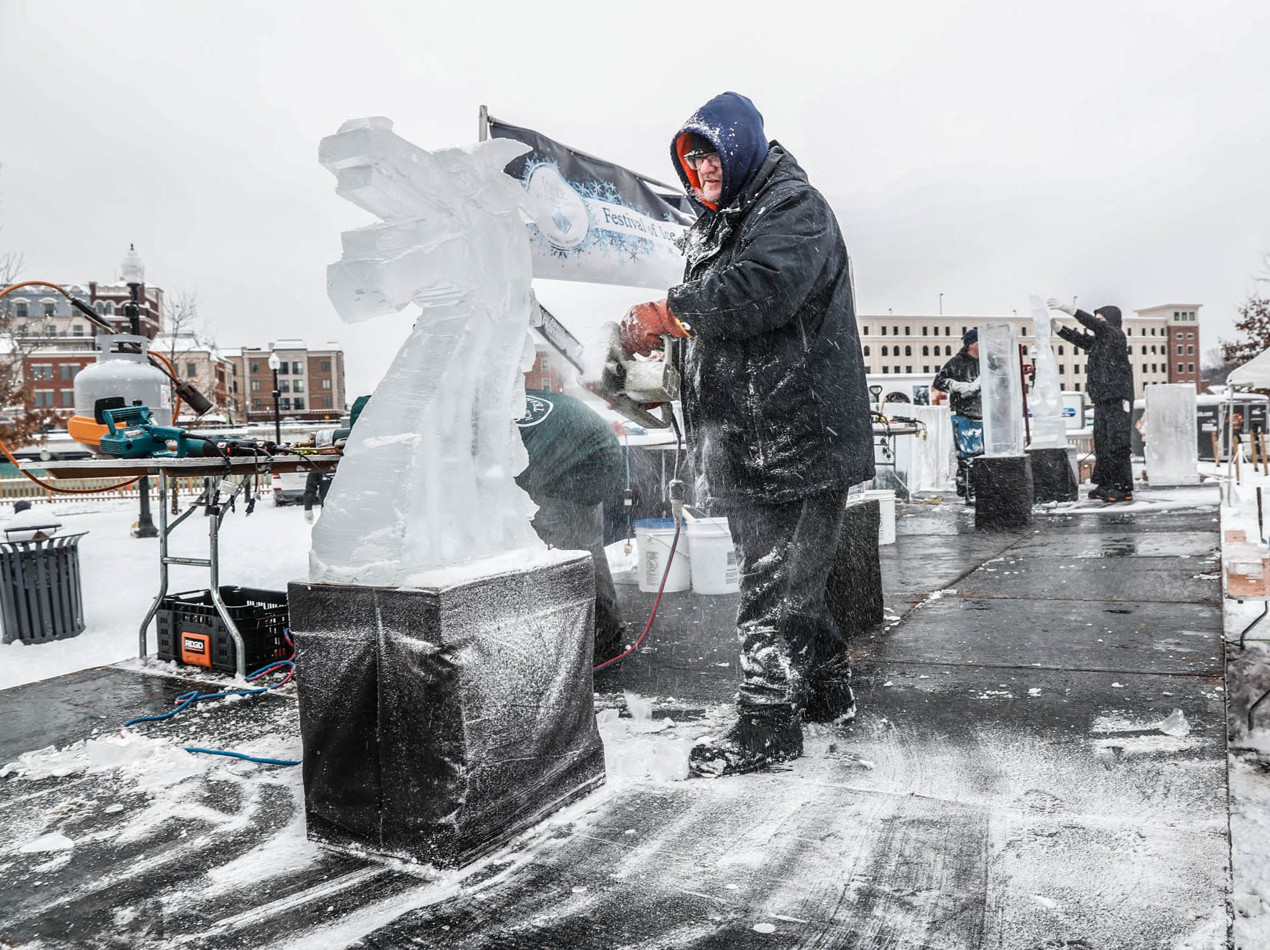 "Sculptors Greg Butauski, left, and Stephan Koch, right, battle each other in a speed ""carve off"" which took place during the second annual Carmel Festival of Ice, held at Center Green in Carmel Ind. on Sunday, Jan. 13, 2019."