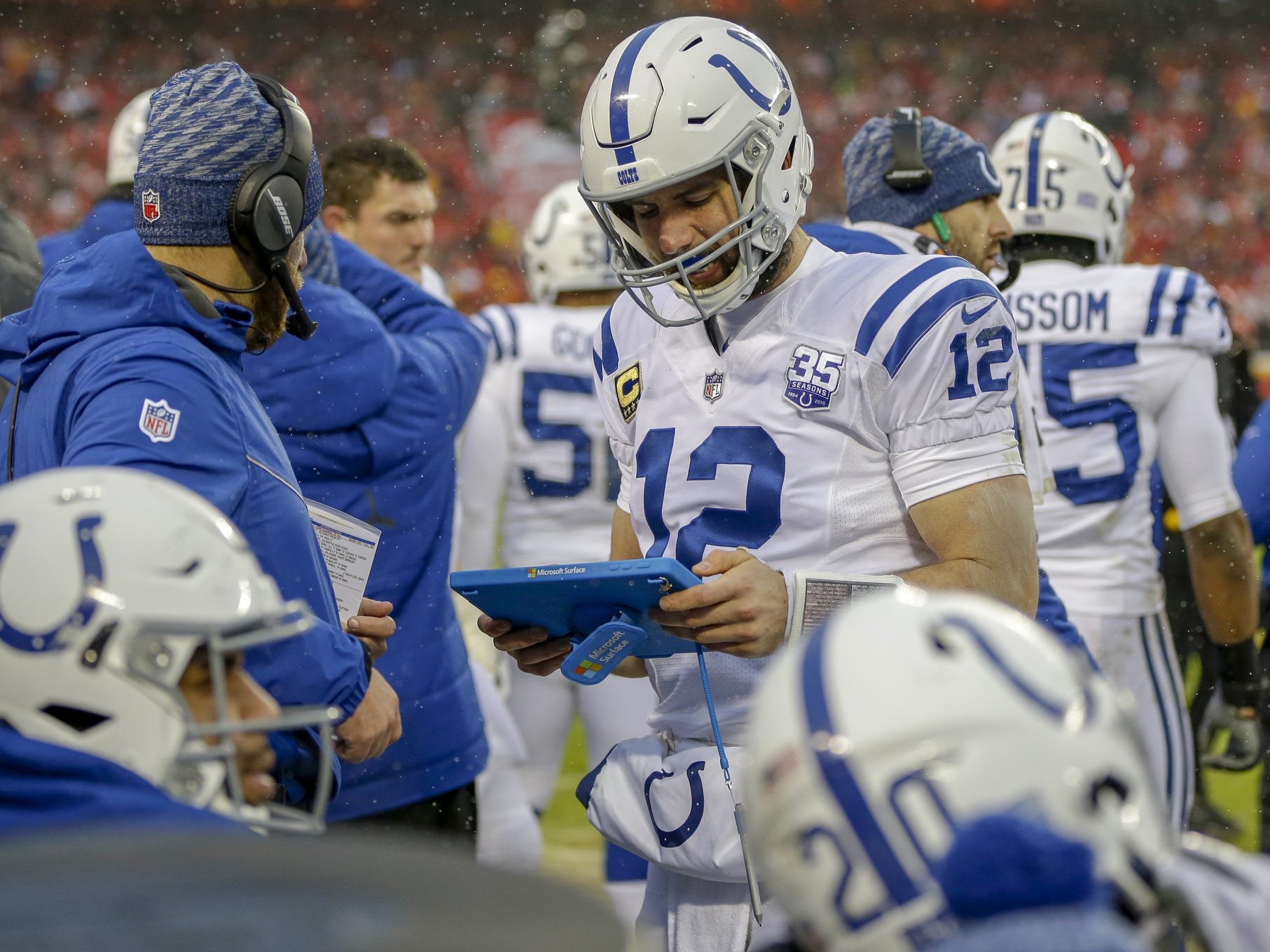 Indianapolis Colts quarterback Andrew Luck (12) looks at a tablet after a three and out against the Kansas City Chiefs in the second quarter at Arrowhead Stadium in Kansas City, Mo., on Saturday, Jan. 12, 2019.