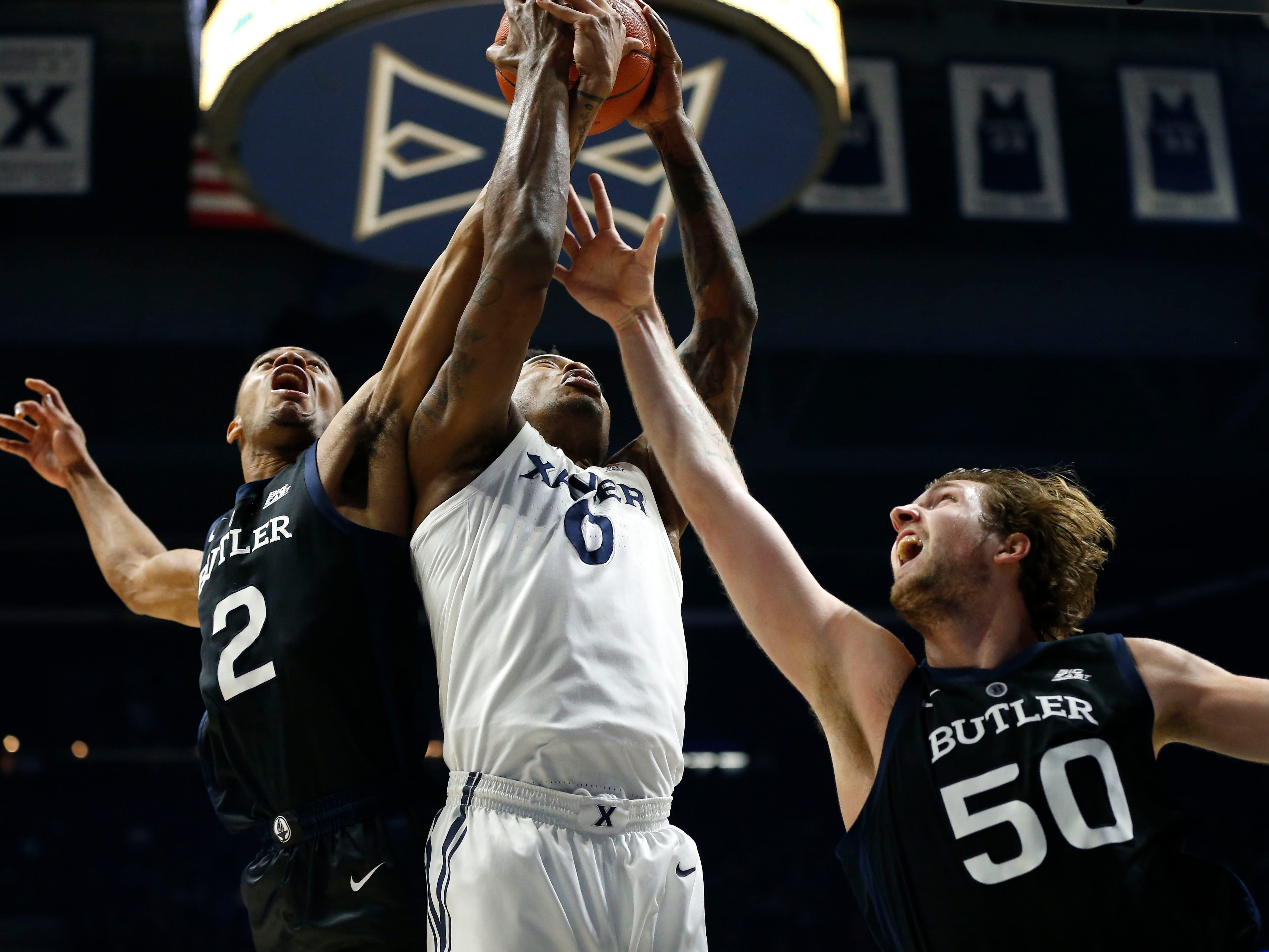 Jan 13, 2019; Cincinnati, OH, USA; Xavier Musketeers forward Tyrique Jones (0) goes for the ball during the first half against the Butler Bulldogs guard Aaron Thompson (2) and forward Joey Brunk (50) at the Cintas Center.