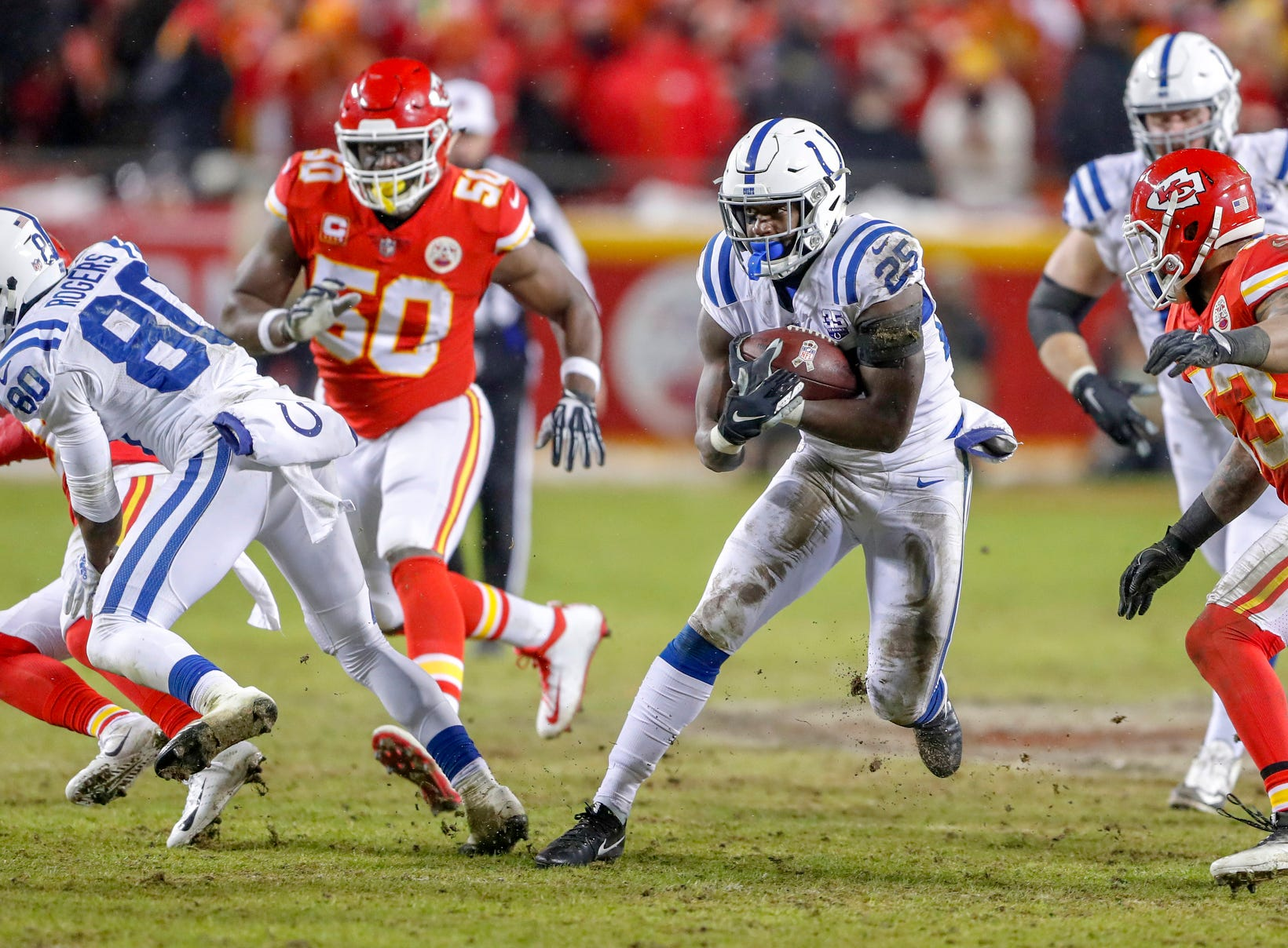 Indianapolis Colts running back Marlon Mack (25) rushes against the Kansas City Chiefs in the third quarter at Arrowhead Stadium in Kansas City, Mo., on Saturday, Jan. 12, 2019.