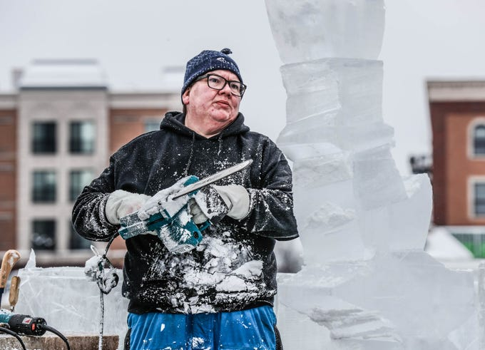 "Sculptor Stephan Koch creates a shark sculpture from ice during a speed ""carve off"" which took place during the second annual Carmel Festival of Ice, held at Center Green in Carmel Ind. on Sunday, Jan. 13, 2019. Koch  won the first round of competition."
