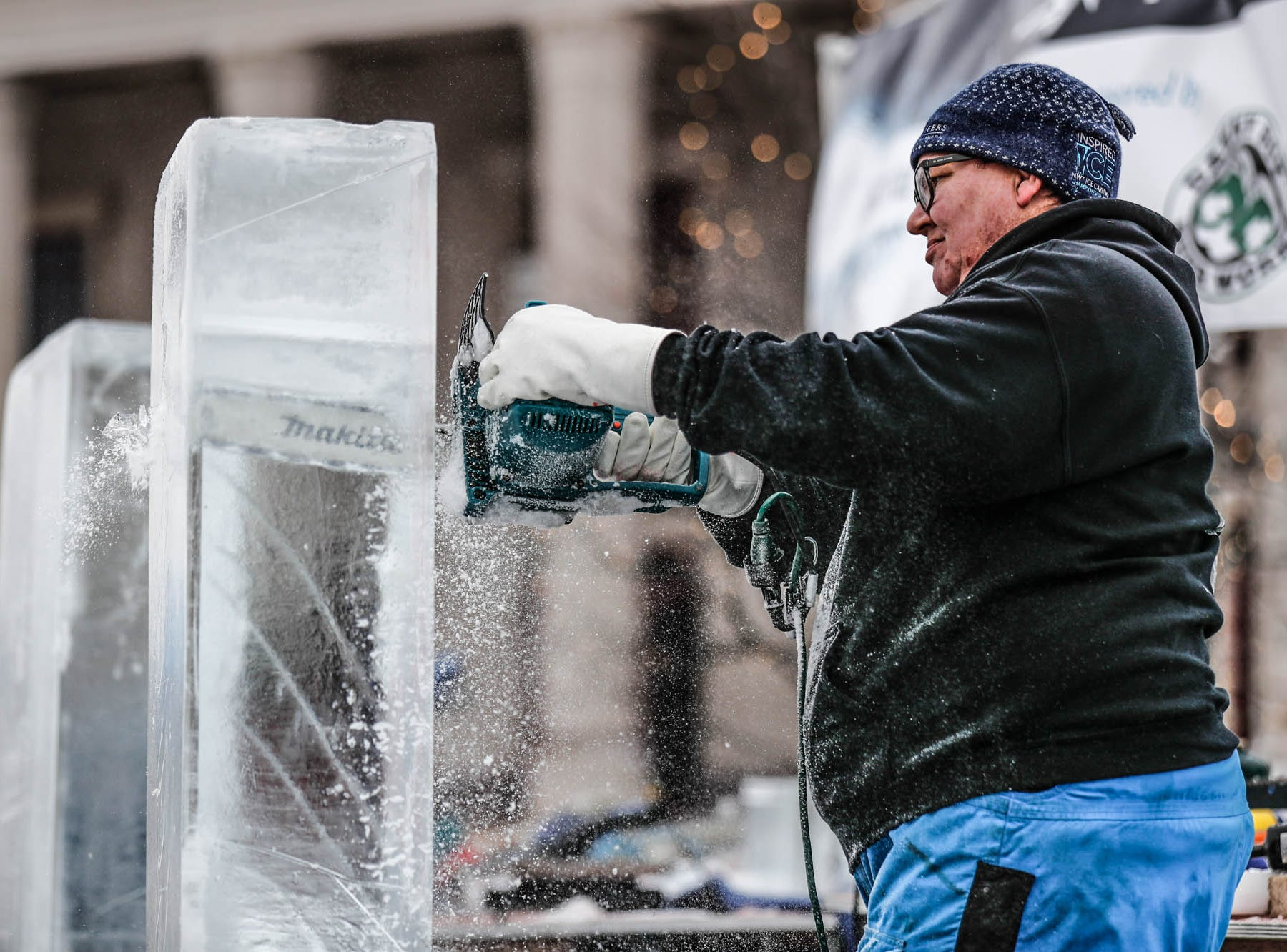 "Sculptor Stephan Koch begins his sculpture for a speed ""carve off"" which took place during the second annual Carmel Festival of Ice, held at Center Green in Carmel Ind. on Sunday, Jan. 13, 2019."