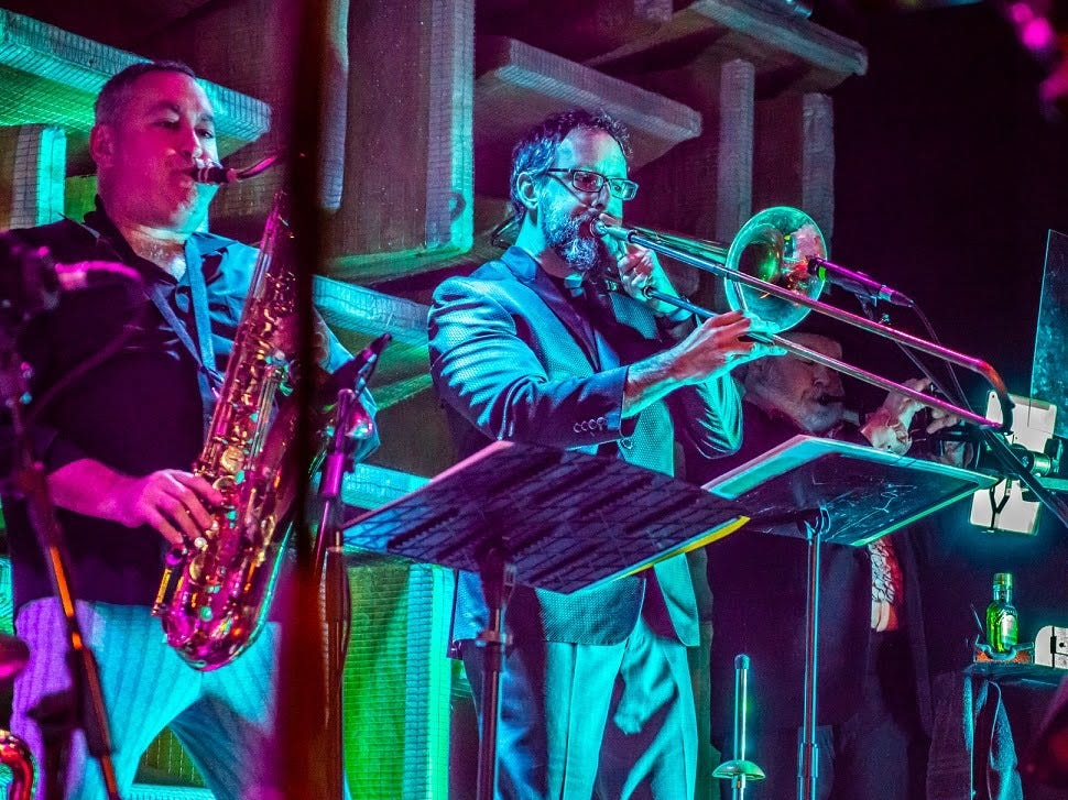 """Saxophone player Josh Silbert, trombone player Charlie Krone and trumpet player Eric Evans perform as part of """"the Band"""" during Saturday's """"Such a Night"""" fundraiser for GiGi's Playhouse Indianapolis at the Hi-Fi."""
