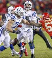 Indianapolis Colts quarterback Andrew Luck (12) is strip sacked by the Kansas City Chiefs defense in the third quarter at Arrowhead Stadium in Kansas City, Mo., on Saturday, Jan. 12, 2019.