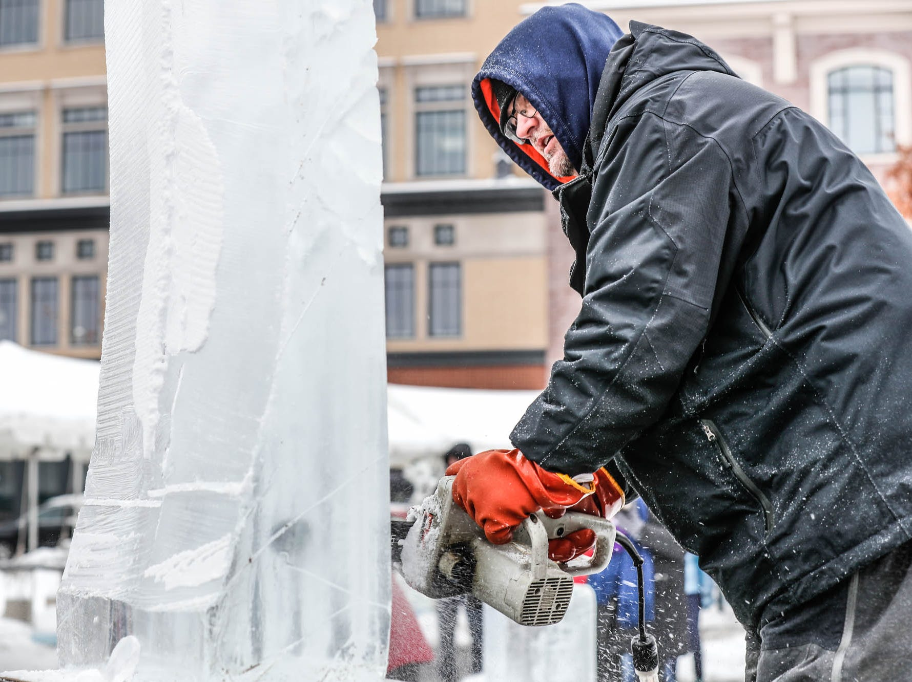 "Sculptor Greg Butauski begins his sculpture for a speed ""carve off"" which took place during the second annual Carmel Festival of Ice, held at Center Green in Carmel Ind. on Sunday, Jan. 13, 2019."