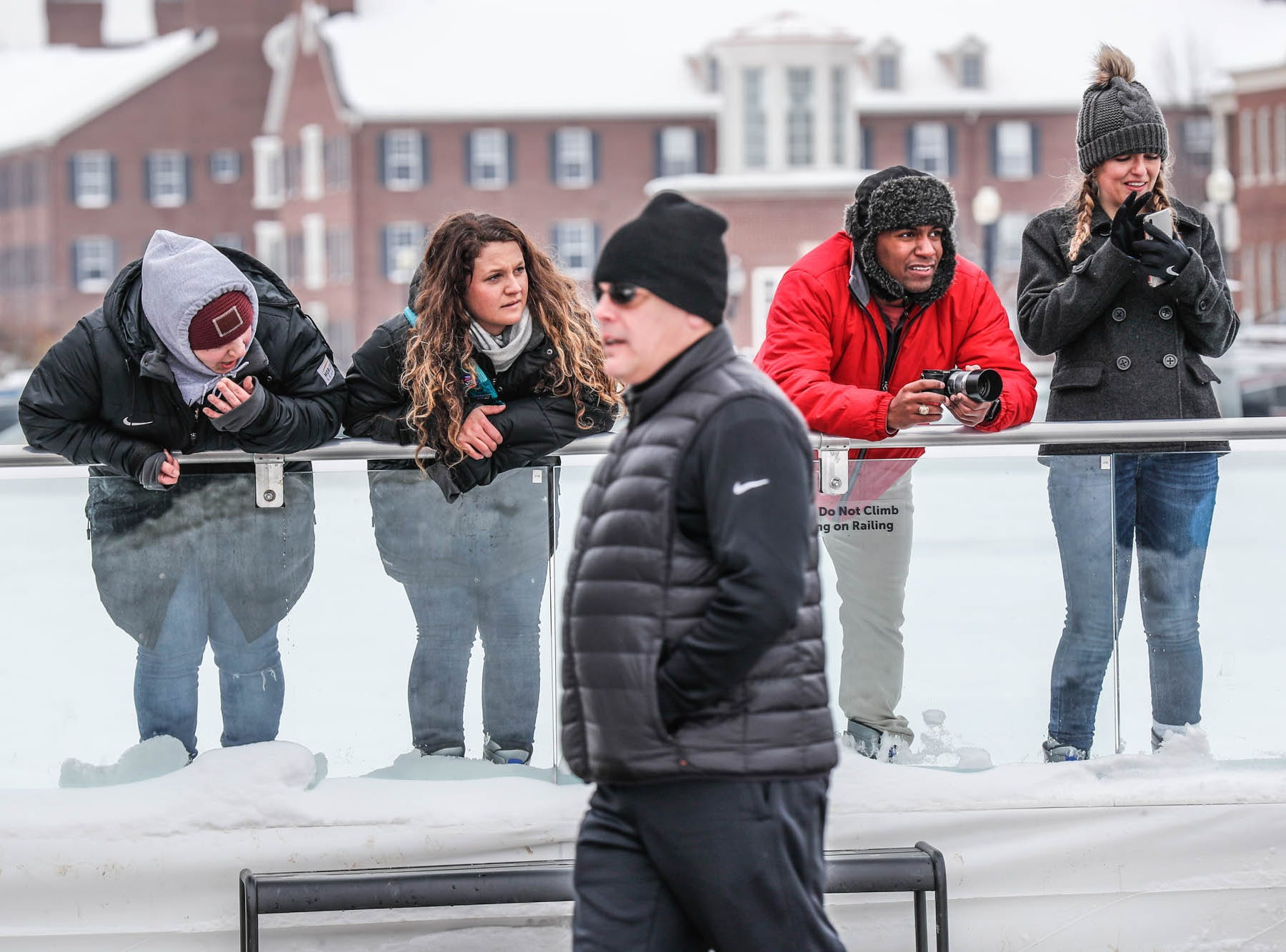 "Visitors watch a speed ice ""carve off"" from the skating rink  during the second annual Carmel Festival of Ice, held at Center Green in Carmel Ind. on Sunday, Jan. 13, 2019."