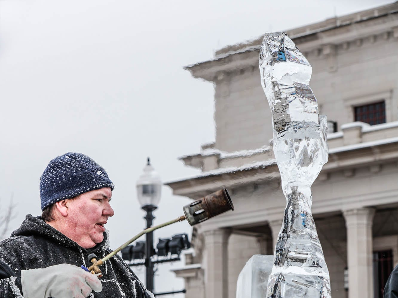 "Sculptor Stephan Koch uses a torch to put the finishing touches on a shark ice sculpture he created during a speed ""carve off"" which took place during the second annual Carmel Festival of Ice, held at Center Green in Carmel Ind. on Sunday, Jan. 13, 2019."