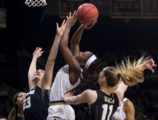 Notre Dame's Jackie Young, center, shoots between Wake Forest's Christina Morra (23) and Ivana Raca (11) during the second half of an NCAA college basketball game Sunday, Jan. 13, 2019, in South Bend, Ind.