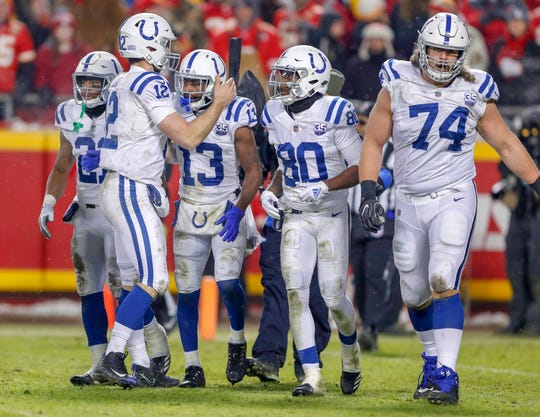 Indianapolis Colts quarterback Andrew Luck (12) congratulates wide receiver T.Y. Hilton (13) after a late touchdown in the fourth quarter at Arrowhead Stadium in Kansas City, Mo., on Saturday, Jan. 12, 2019.