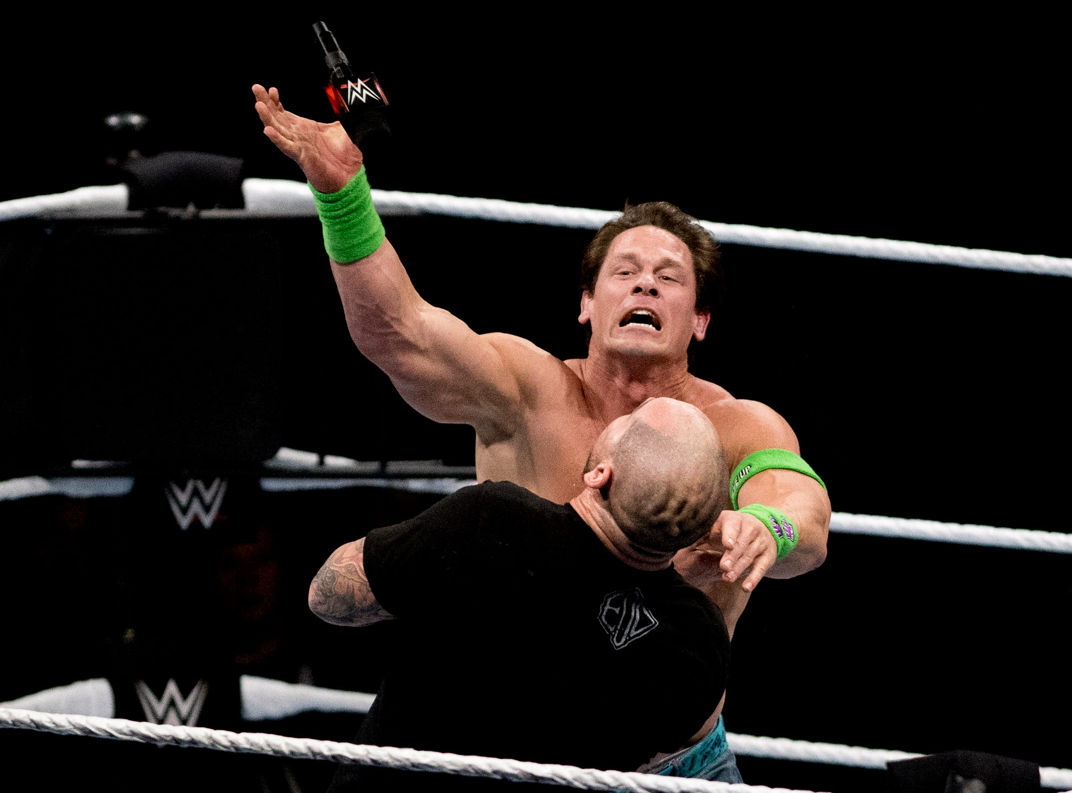 John Cena hits Baron Corbin with a microphone during a WWE Live performance at the Knoxville Civic Coliseum in Knoxville, Tennessee on Saturday, January 12, 2019. *KNOXVILLE NEWS SENTINEL USE ONLY*