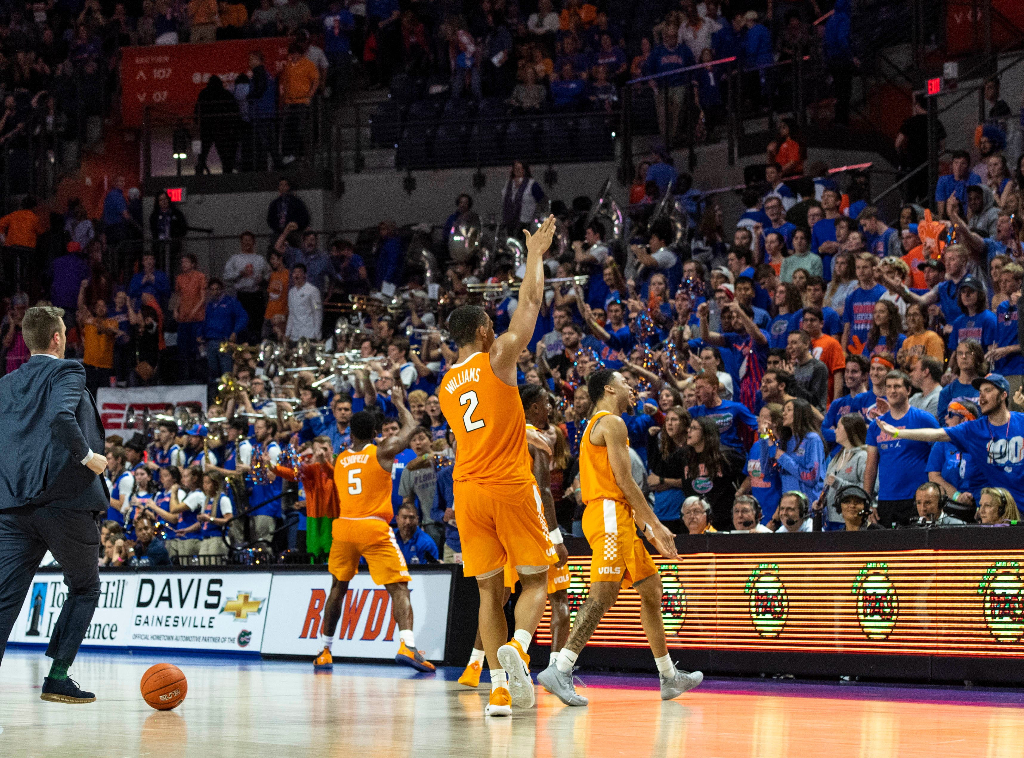 Tennessee Volunteers forward Grant Williams (2) and guard Admiral Schofield (5) taunt the fans with the Gator chomp after winning the game against the Florida Gators at Exactech Arena on Jan. 12, 2019.