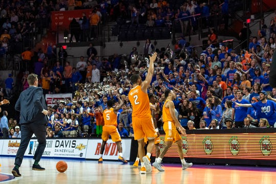 Tennessee players Grant Williams (2) and guard Admiral Schofield (5) taunt fans with the Gator chomp after beating Florida on Saturday.