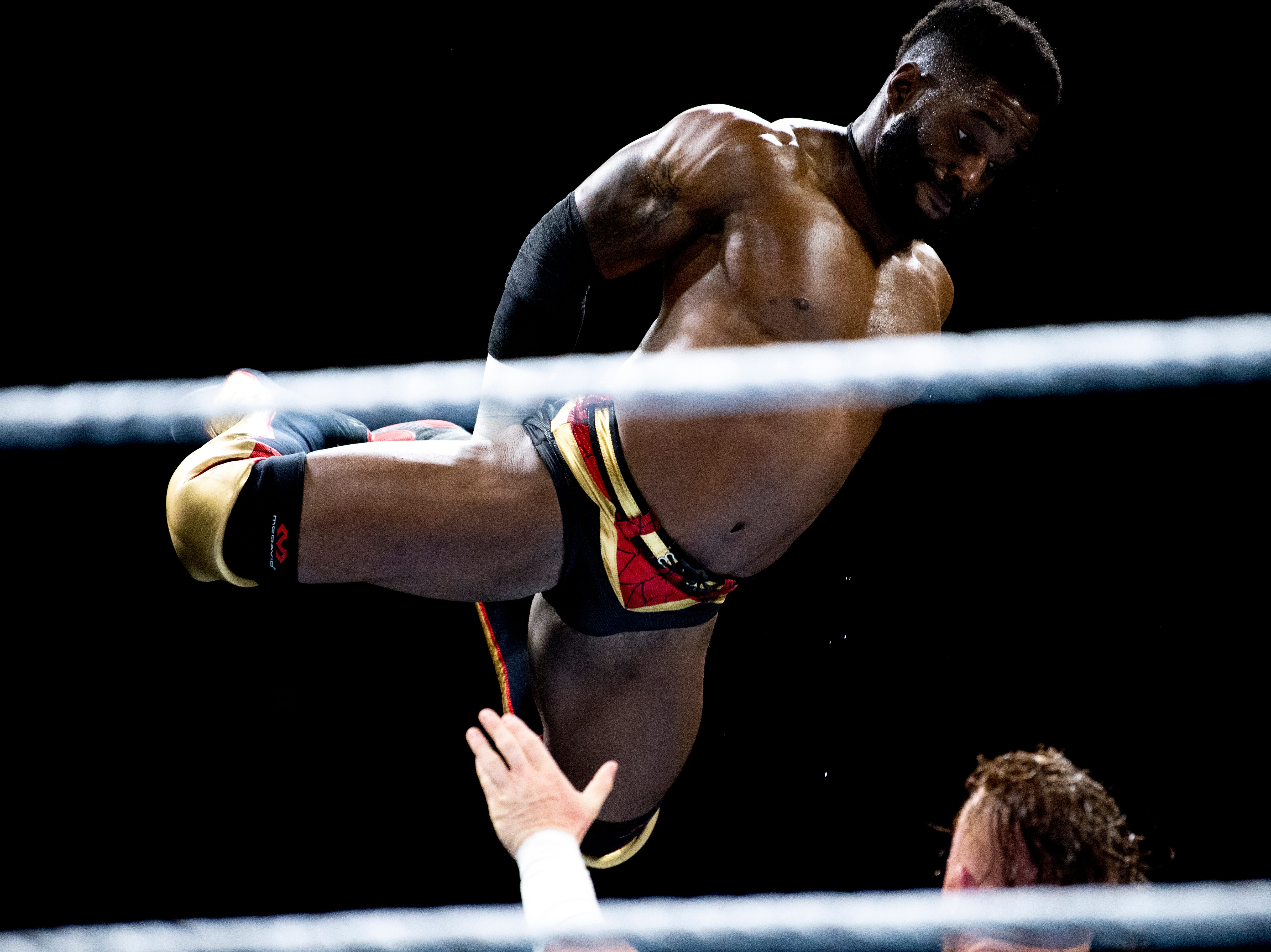 Cedric Alexander leaps onto Buddy Murphy for the Cruiserweight Championship Belt during a WWE Live performance at the Knoxville Civic Coliseum in Knoxville, Tennessee on Saturday, January 12, 2019. *KNOXVILLE NEWS SENTINEL USE ONLY*