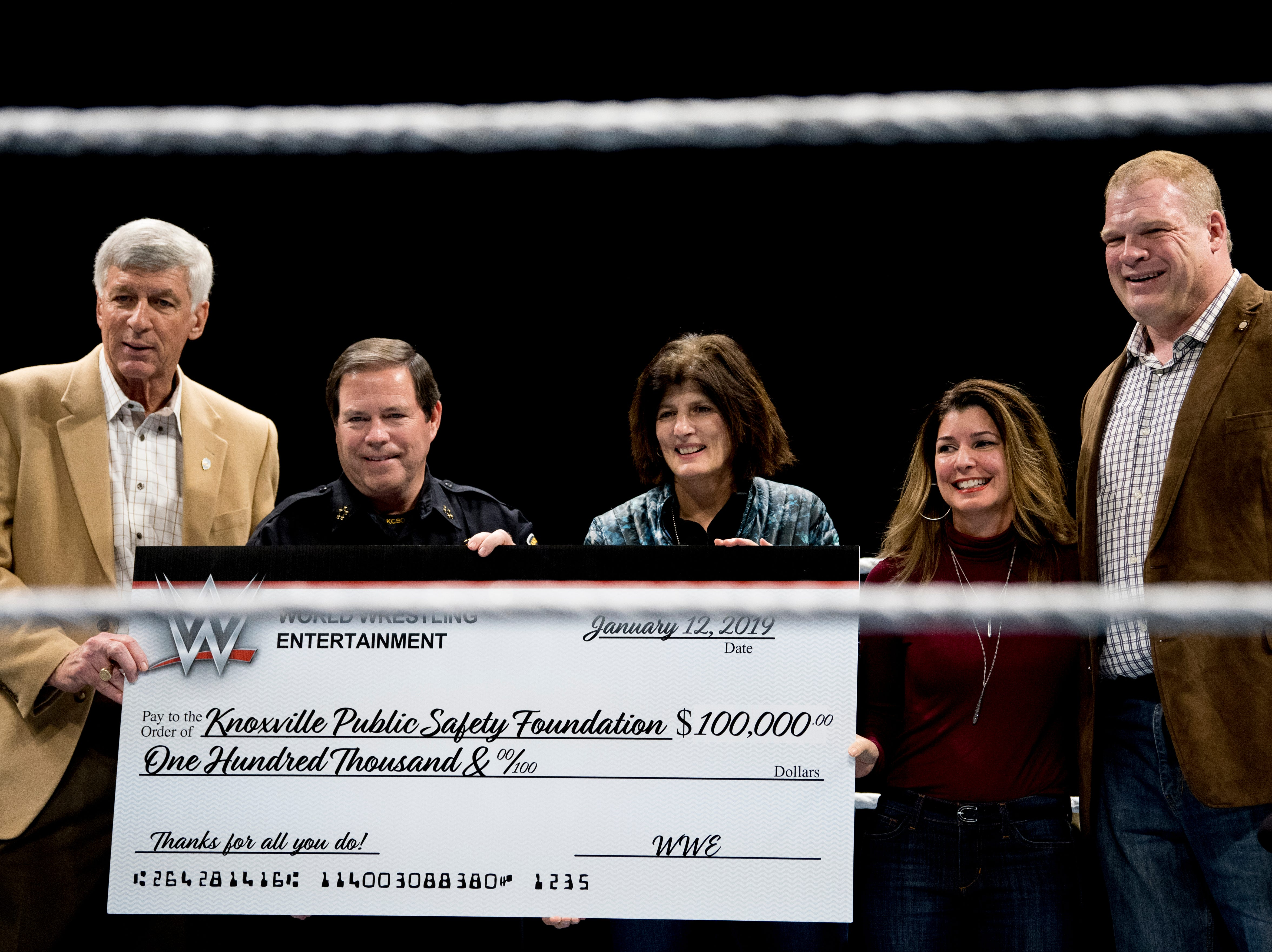 Knox County Mayor Glenn Jacobs, aka WWE wrestler Kane, presents a check to the Knoxville Public Safety Foundation during a WWE Live performance at the Knoxville Civic Coliseum in Knoxville, Tennessee on Saturday, January 12, 2019. *KNOXVILLE NEWS SENTINEL USE ONLY*
