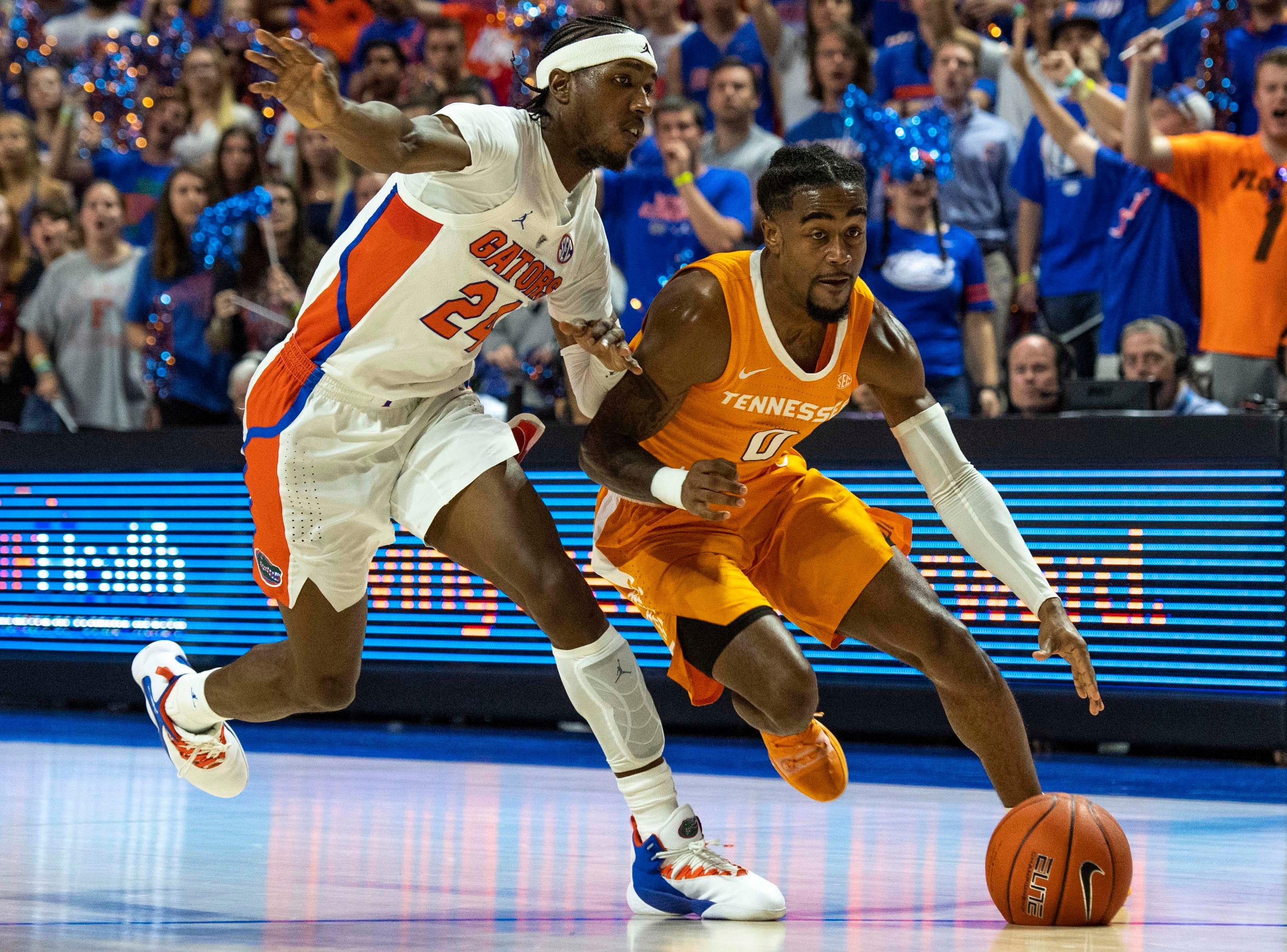 Tennessee Volunteers guard Jordan Bone (0) drives for the basket as Florida Gators guard Deaundrae Ballard (24) defends on Jan. 12, 2019.