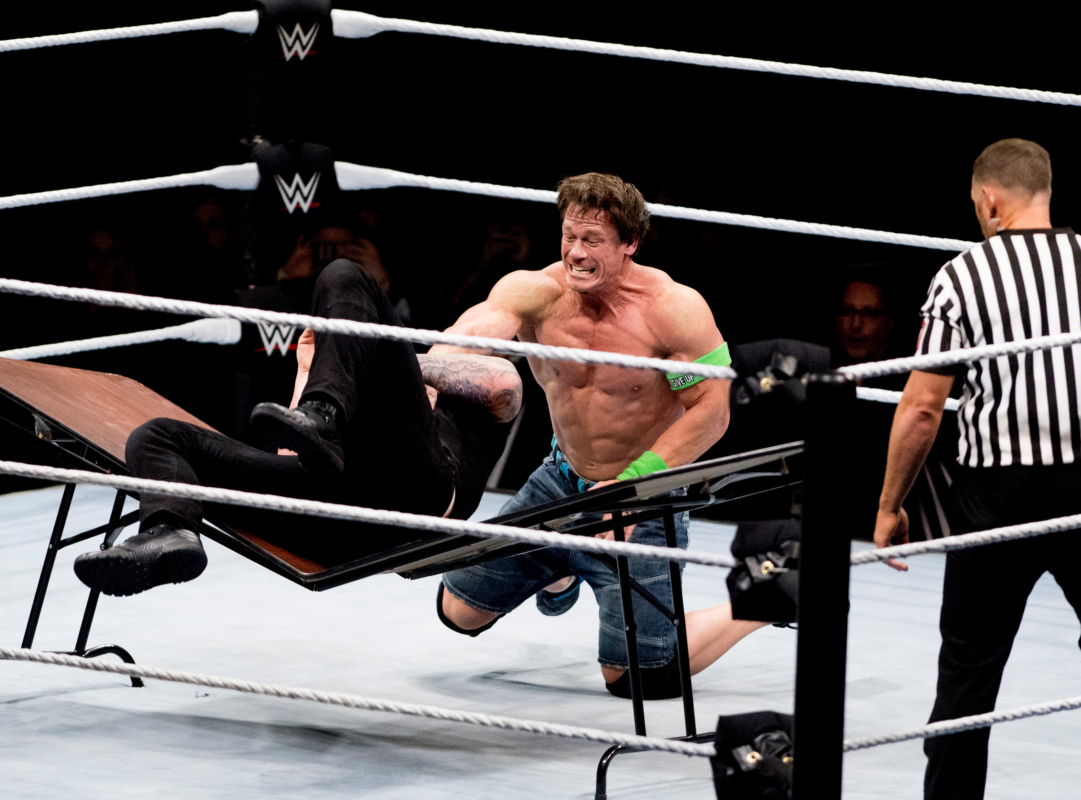 John Cena body slams Baron Corbin into a table to win the match during a WWE Live performance at the Knoxville Civic Coliseum in Knoxville, Tennessee on Saturday, January 12, 2019. *KNOXVILLE NEWS SENTINEL USE ONLY*