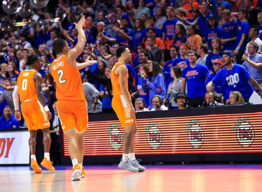 Tennessee players Jordan Bone (0) and Grant Williams (2) and Lamonte Turner (1) do the Gator chomp in front of Florida fans on  Jan. 12, 2019, in Gainesville, Fla. Tennessee won 78-67