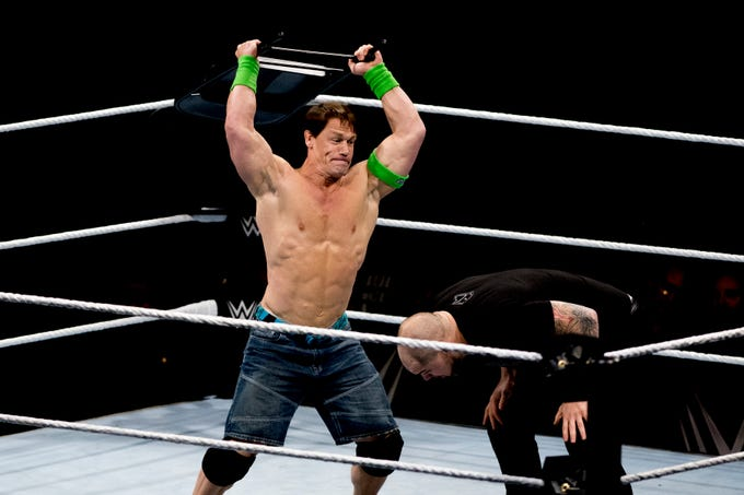 John Cena slams a chair on Baron Corbin during a WWE Live performance at the Knoxville Civic Coliseum in Knoxville, Tennessee on Saturday, January 12, 2019. *KNOXVILLE NEWS SENTINEL USE ONLY*