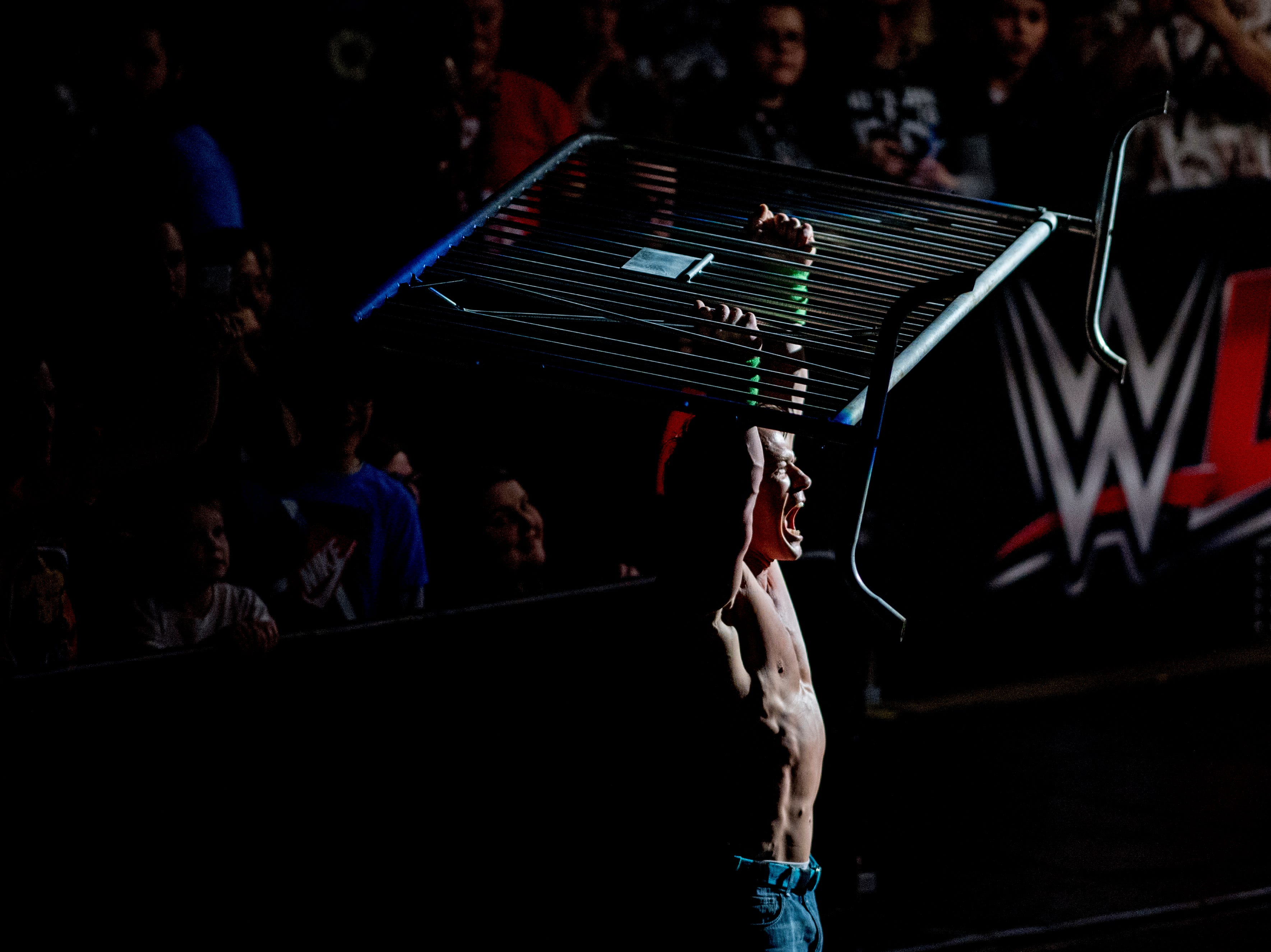 John Cena holds up a iron gate after hitting Baron Corbin with it during a WWE Live performance at the Knoxville Civic Coliseum in Knoxville, Tennessee on Saturday, January 12, 2019. *KNOXVILLE NEWS SENTINEL USE ONLY*