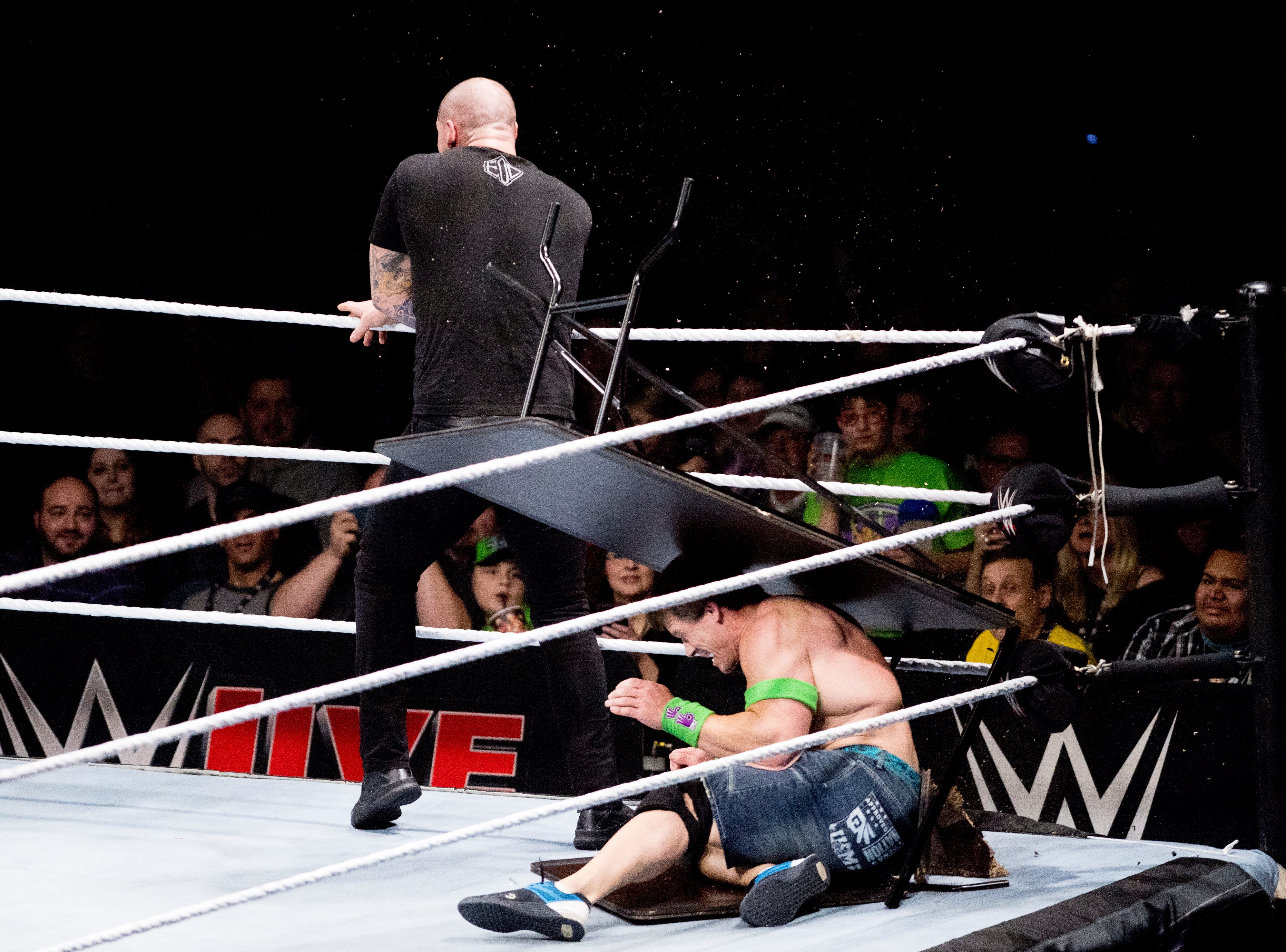 Baron Corbin throws John Cena into a table during a WWE Live performance at the Knoxville Civic Coliseum in Knoxville, Tennessee on Saturday, January 12, 2019. *KNOXVILLE NEWS SENTINEL USE ONLY*