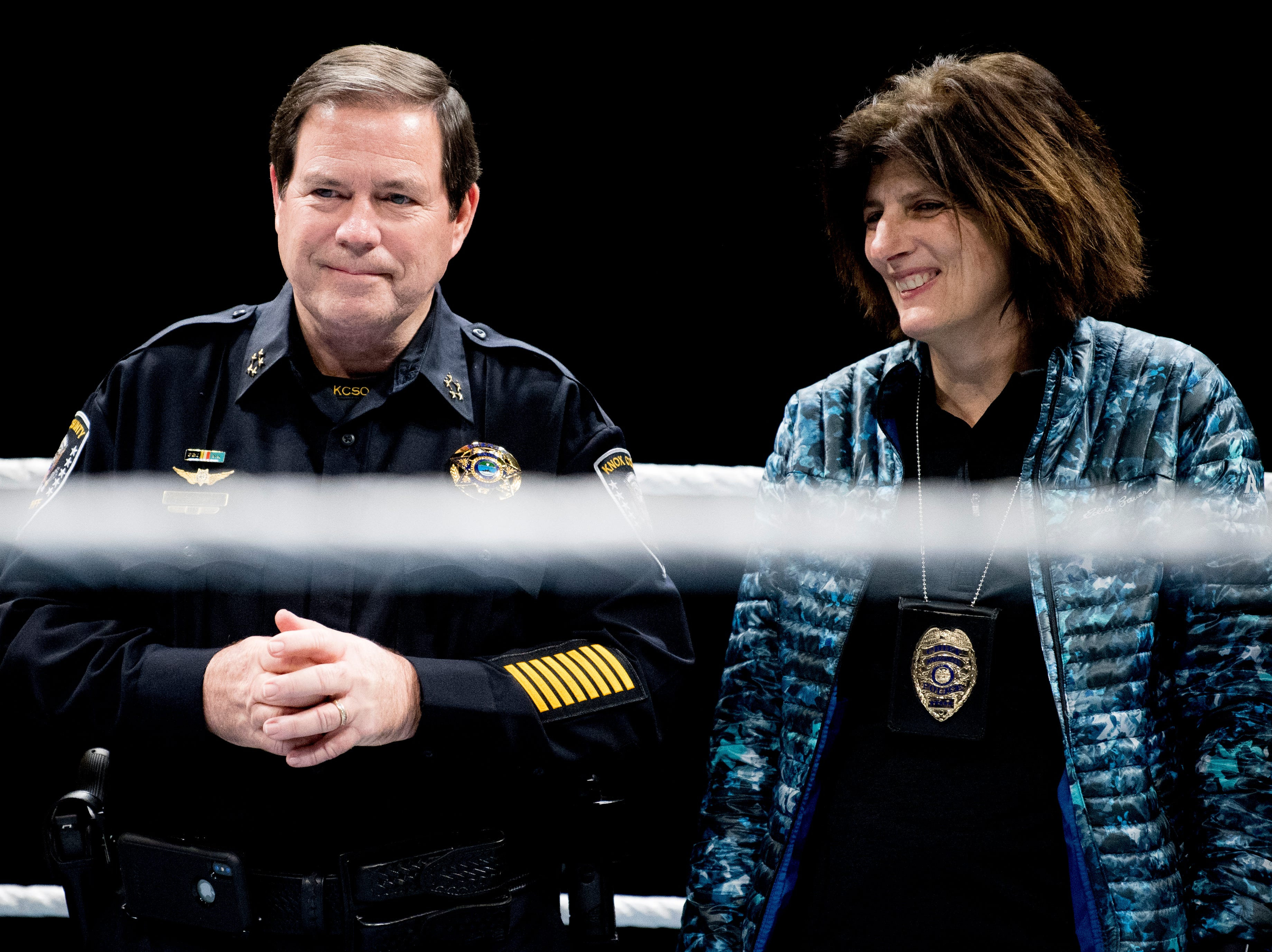 Knox County Sheriff Tom Spangler and Knoxville Chief of Police Eve Thomas stand in the wrestling ring together during a check presentation during a WWE Live performance at the Knoxville Civic Coliseum in Knoxville, Tennessee on Saturday, January 12, 2019. *KNOXVILLE NEWS SENTINEL USE ONLY*
