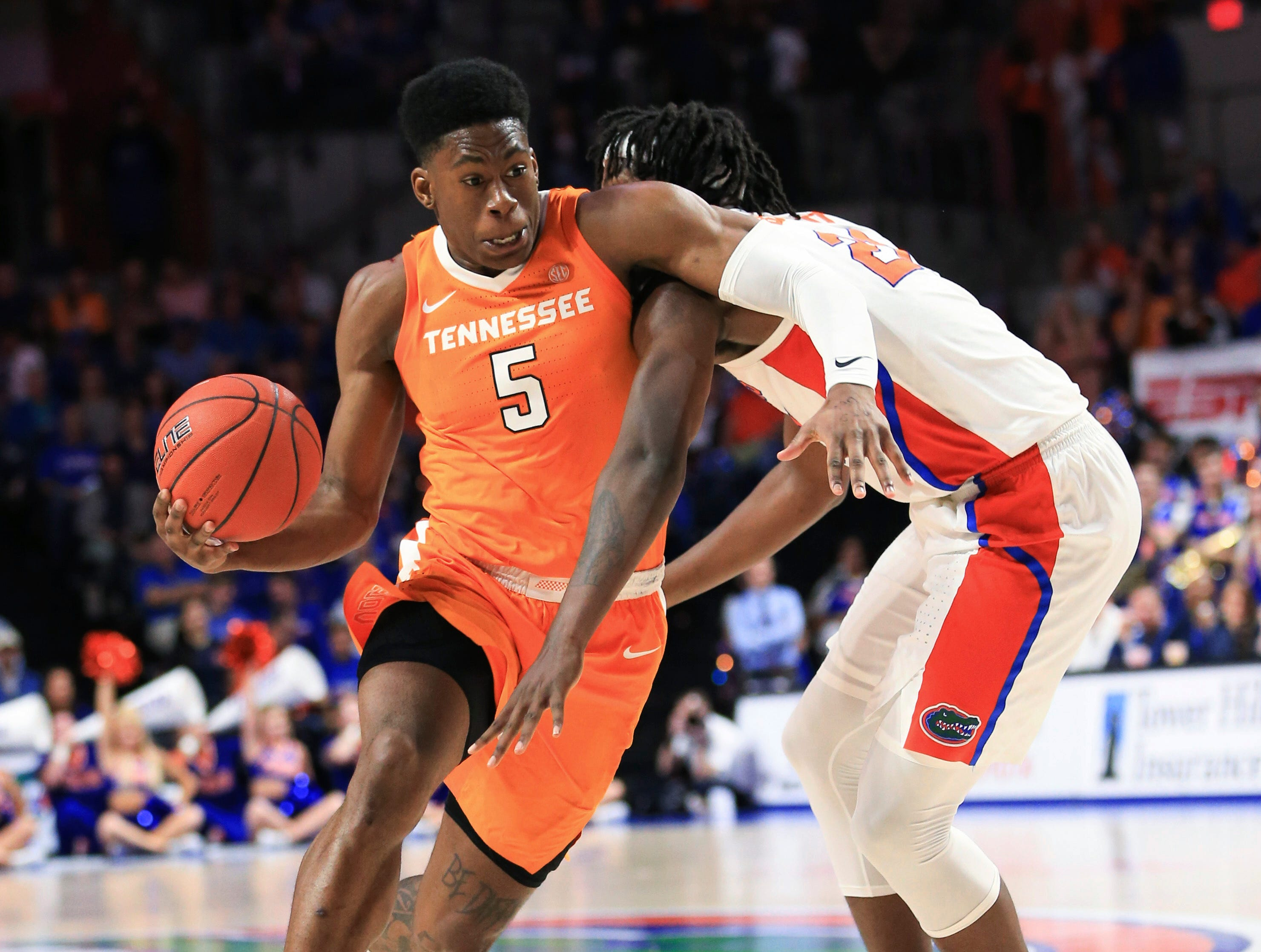Tennessee guard Admiral Schofield (5) drives past Florida forward Dontay Bassett (21) on Jan. 12, 2019.
