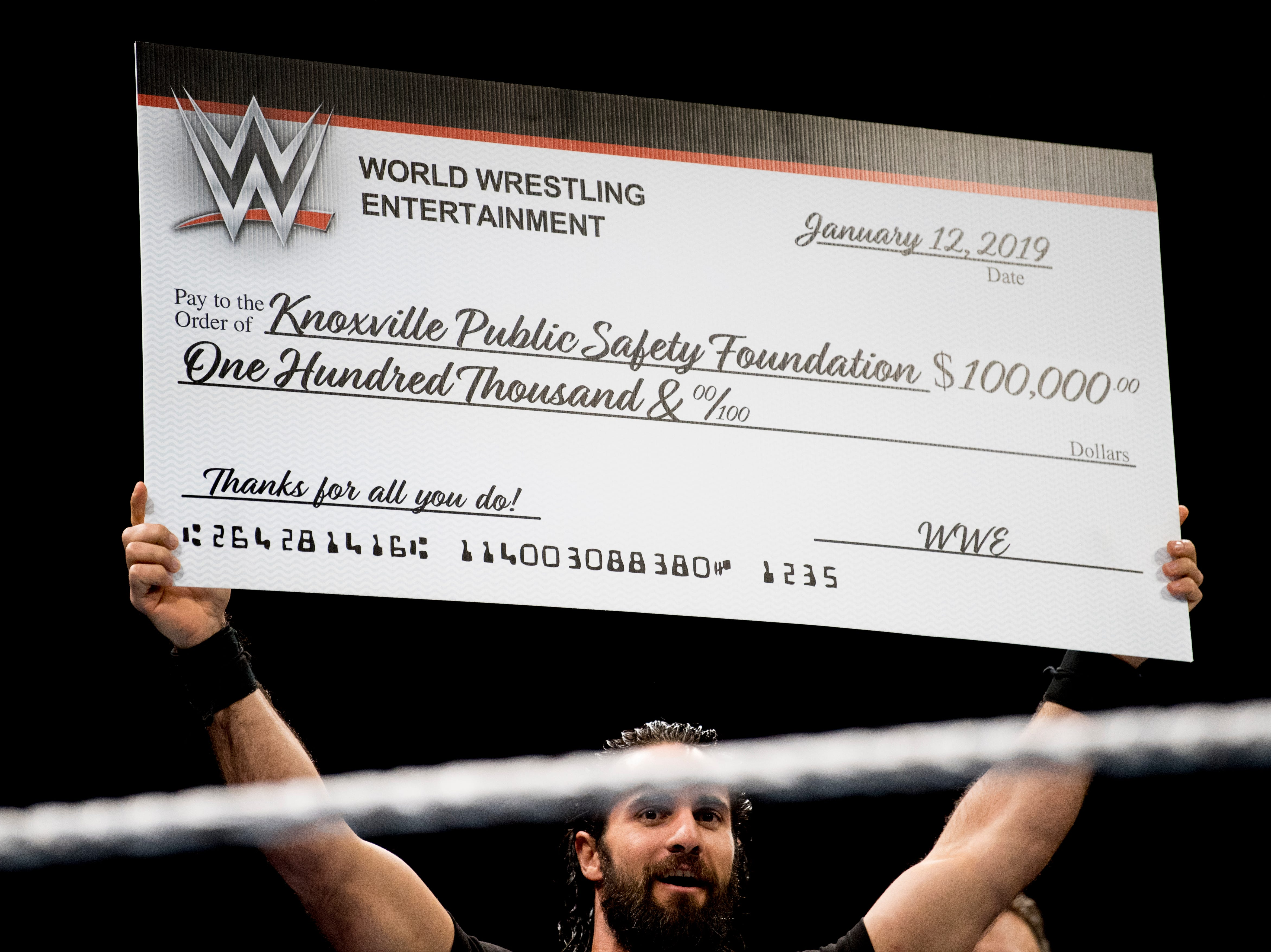 Seth Rollins holds a check from WWE to the Knoxville Public Safety Foundation during a WWE Live performance at the Knoxville Civic Coliseum in Knoxville, Tennessee on Saturday, January 12, 2019. *KNOXVILLE NEWS SENTINEL USE ONLY*