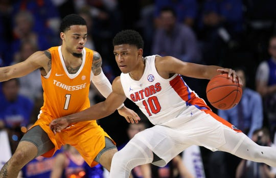 Florida guard Noah Locke (10) is defended by Tennessee's Lamonte Turner (1) on Saturday.