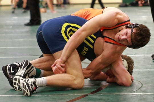 Brighton's River Shettler (top) tries to flip Hartland's Tanner Culver during a 171-pound match on Saturday, Jan. 12, 2019 at Novi.
