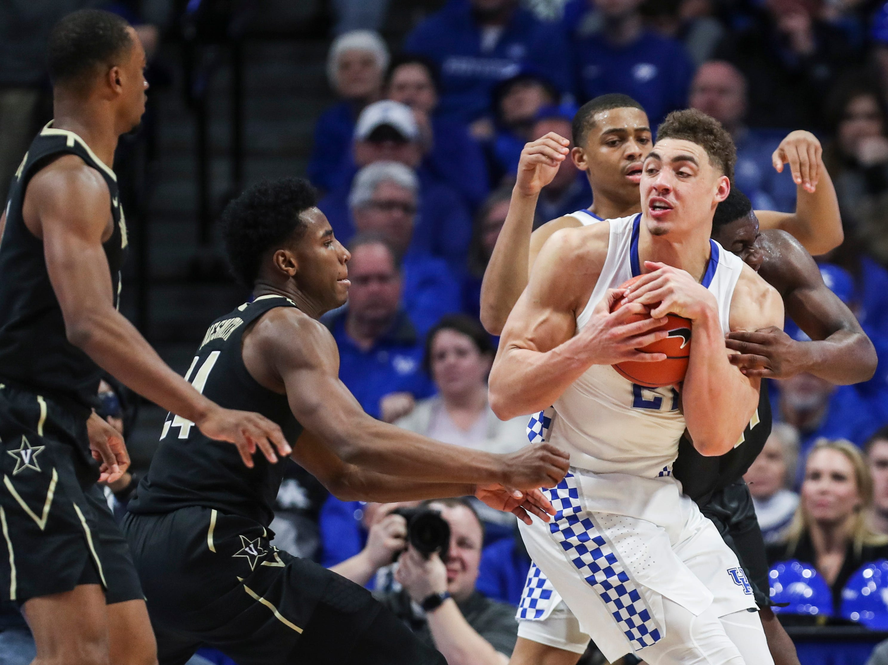 Kentucky's Reid Travis wrestles down one of his 12 rebounds against Vandy Saturday night at Rupp Arena in Lexington. The Cats won 56-47 in a physical game. January 12, 2019