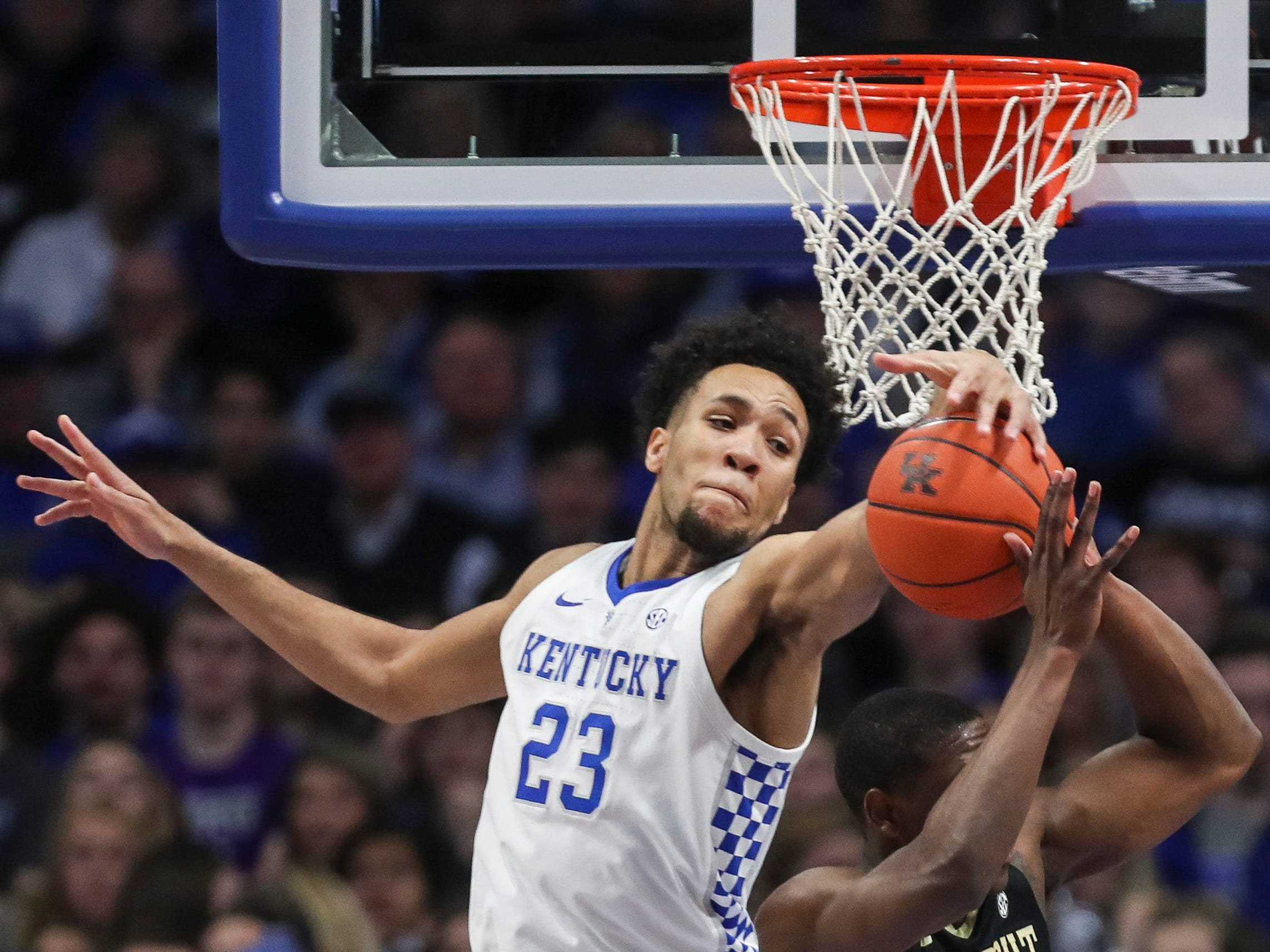 Kentucky's EJ Montgomery blocks the shot of Vanderbilt's Maxwell Evans Saturday night at Rupp Arena in Lexington. January 12, 2019
