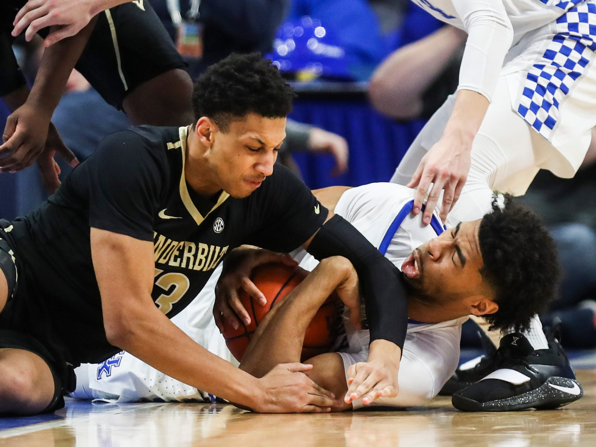 Kentucky's Nick Richards gets hit in the mouth by Vandy's Matthew Moyer, who was called for the foul Saturday night at Rupp Arena in Lexington. January 12, 2019
