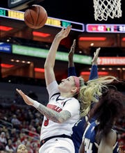 Louisville's Sam Fuehring fights for the offensive rebound. Fuehring had a double-double with a career high 14 rebounds.