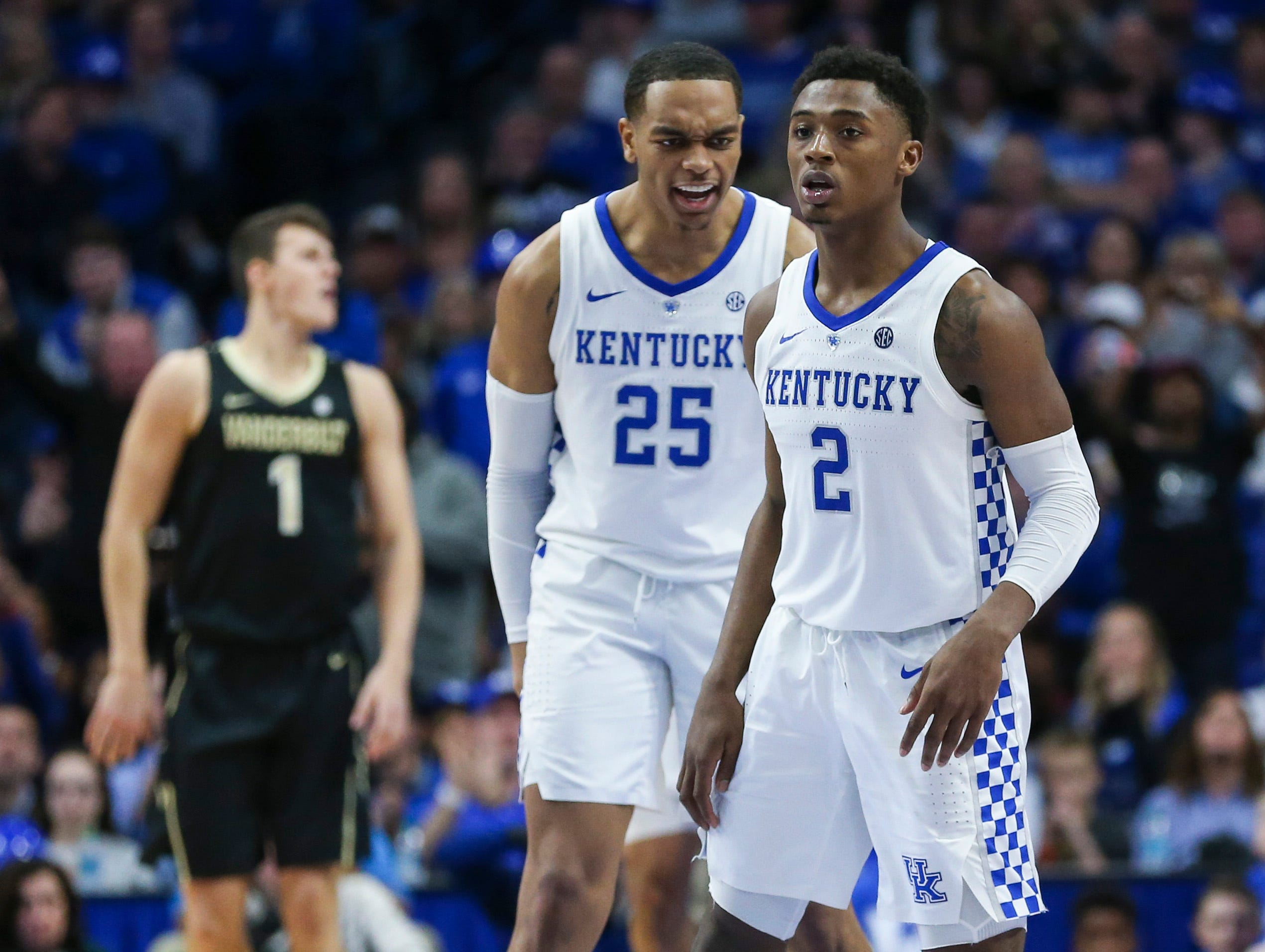Kentucky's PJ Washington Jr. gives encouragement to teammate Ashton Hagans late in the second half against Vanderbilt. January 12, 2019