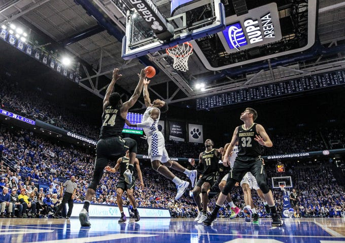 Kentucky's Ashton Hagans gets the two points plus the foul against Vandy Saturday night at Rupp Arena in Lexington. Hagans finished with 15 points. January 12, 2019