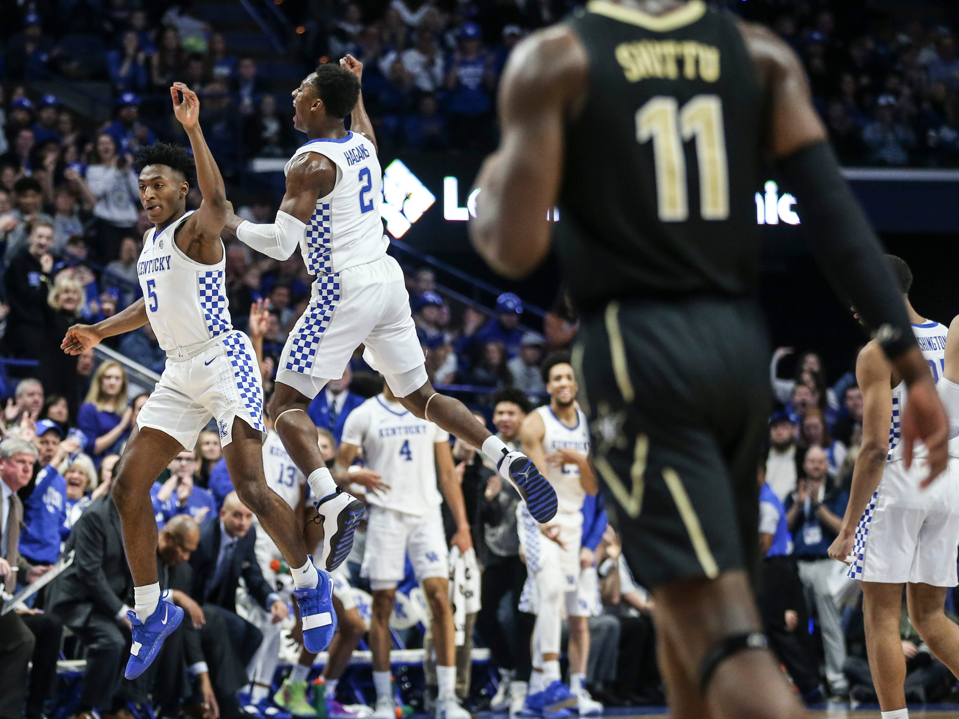 Kentucky's Immanuel Quickley celebrates with Ashton Hagans after Quickley hit a big three point shot against Vanderbilt Saturday night at Rupp Arena in Lexington. January 12, 2019