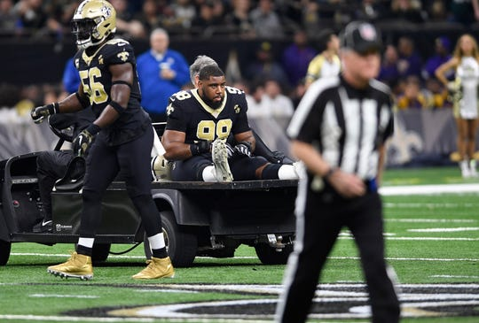 New Orleans Saints defensive tackle Sheldon Rankins (98) leaves the field after injury against the Philadelphia Eagles in the first half of an NFL divisional playoff football game in New Orleans, Sunday, Jan. 13, 2019. (AP Photo/Bill Feig)