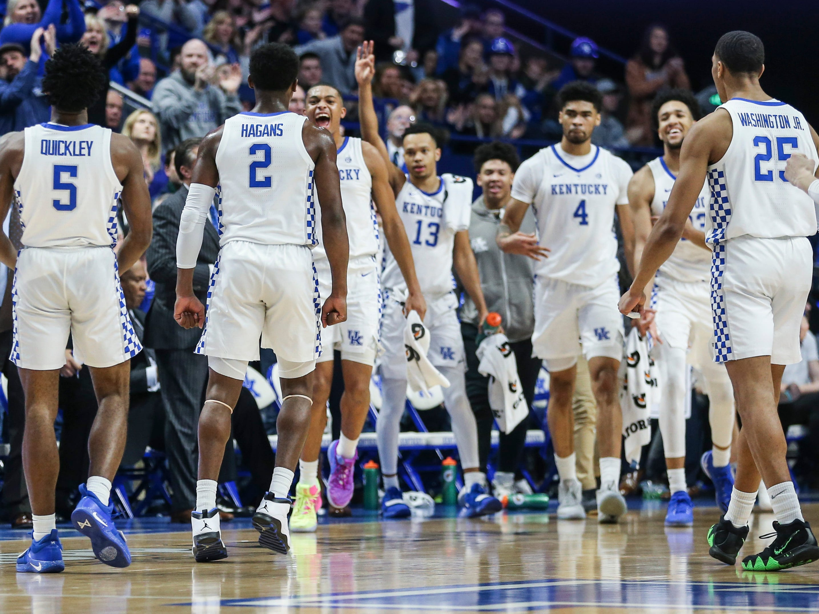 Kentucky's Keldon Johnson yells towards Ashton Hagans as the rest of the Wildcats celebrate after Immanuel Quickly hit a three-pointer to help spark the Wildcats in the first half against Vandy Saturday night at Rupp Arena in Lexington. Quickley finished with 12 points. January 12, 2019