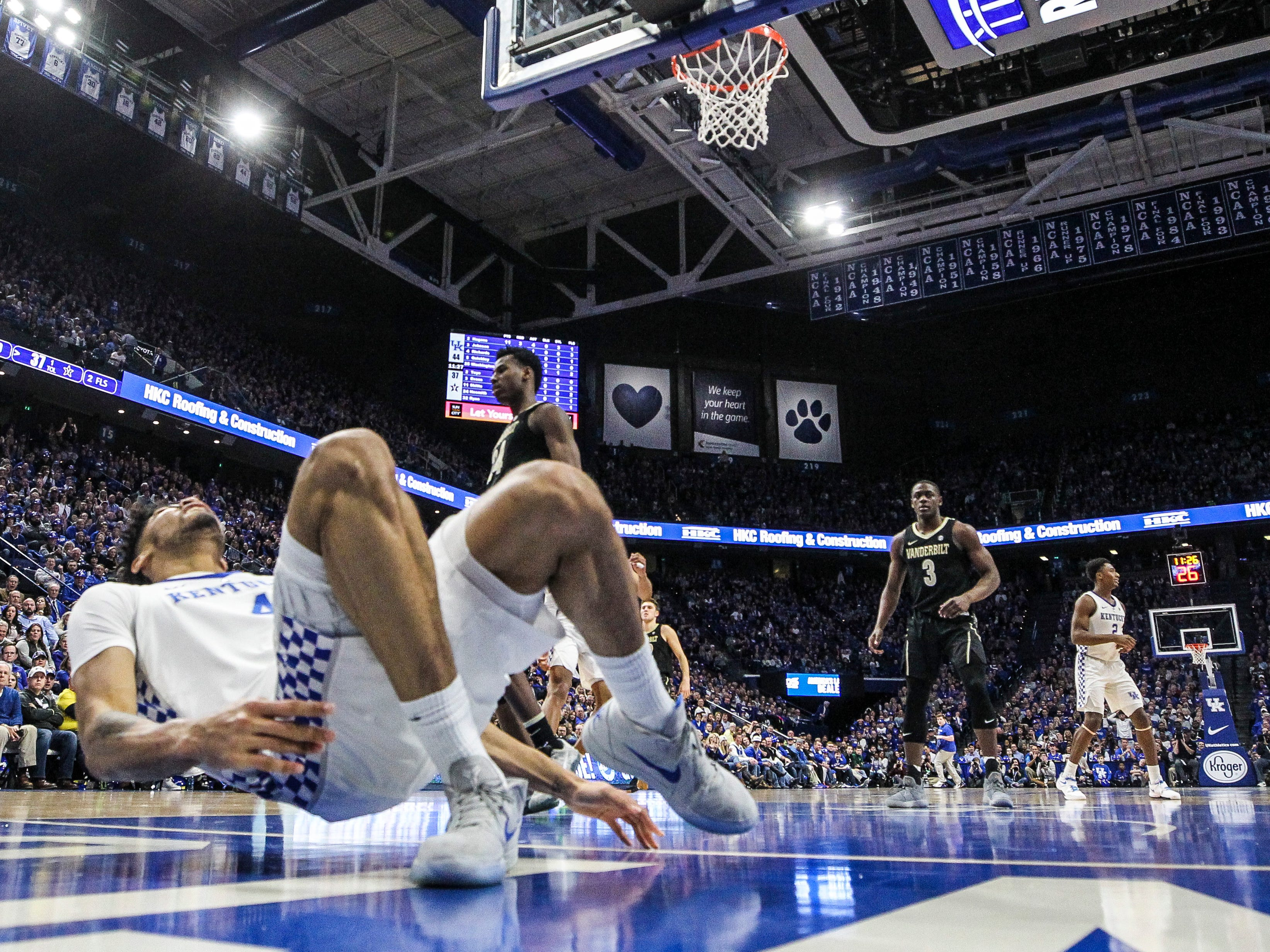 Kentucky's Nick Richards nursed his ankle after landing awkward against Vandy Saturday night at Rupp Arena in Lexington. Richards finished with two points. January 12, 2019