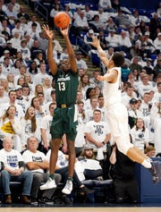 Michigan State's Gabe Brown shoots a 3-point basket as Penn State's Rasir Bolton defends during Sunday's game in State College.