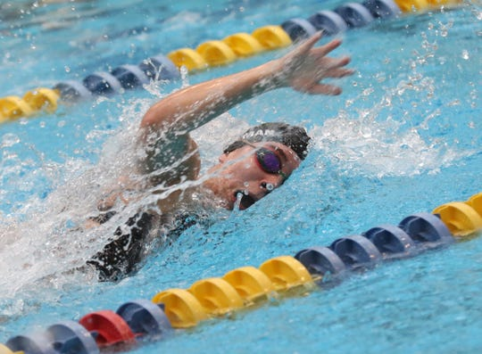 Lexington sophomore Olivia Newman won the 100 freestyle in Saturday's Ohio Cardinal Conference meet