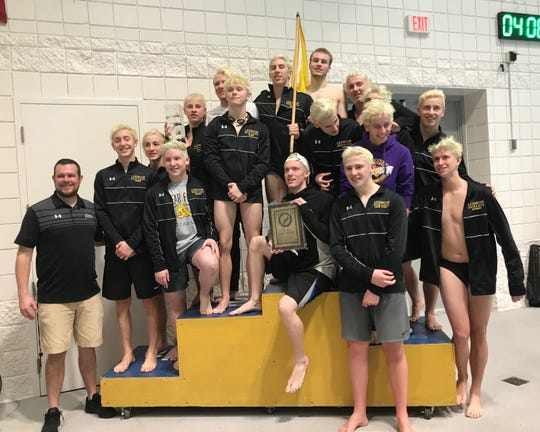 Coach Brock Spurling and his Lexington boys, and team mascot Gadsden (in container, middle row, far left), celebrate a repeat Ohio Cardinal Conference title.