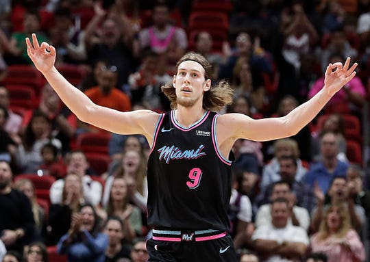 Miami Heat forward Kelly Olynyk celebrates after shooting a 3-pointer in the first half of an NBA basketball game against the Memphis Grizzlies Saturday, Jan. 12, 2019, in Miami. (AP Photo/Brynn Anderson)