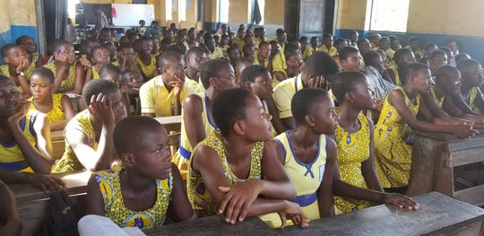 Junior high school students listen during a class at Winneba Methodist School in Ghana. United Methodist Church of Whitefish Bay has donated more than 2,000 books and $6,000 to furnish and stock the school's empty library.