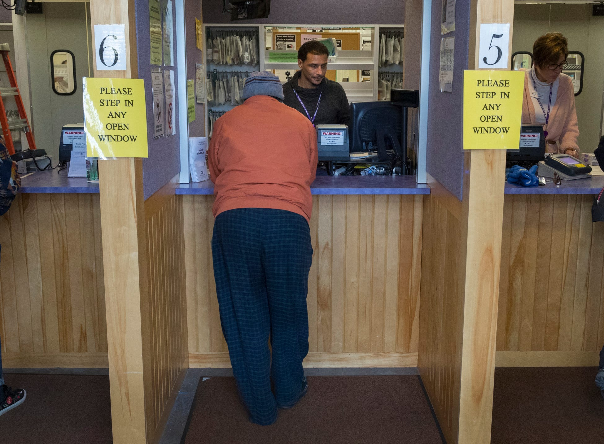 Patients pick up medications at the pharmacy in the Community Health Services clinic on the Oneida Indian Reservation. The pharmacy is the busiest in the Green Bay Area.